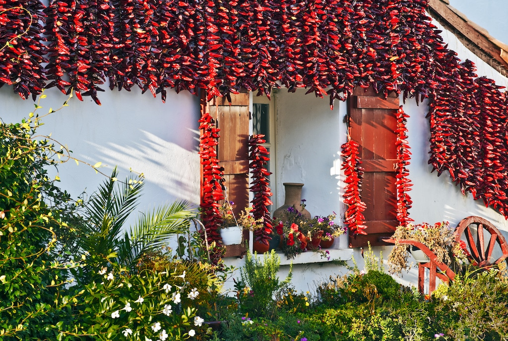 Red Espelette peppers decorating Basque house